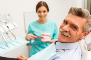 Dentist and smiling patient