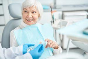 older woman asks about dental bridge lifespan
